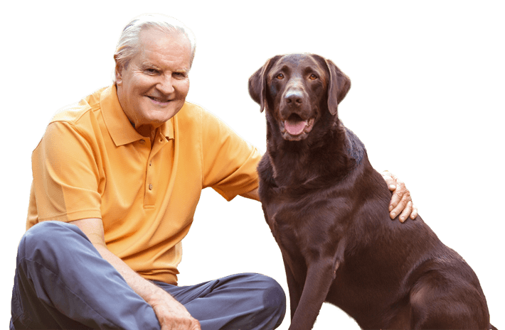 middle aged man sitting next to a dog